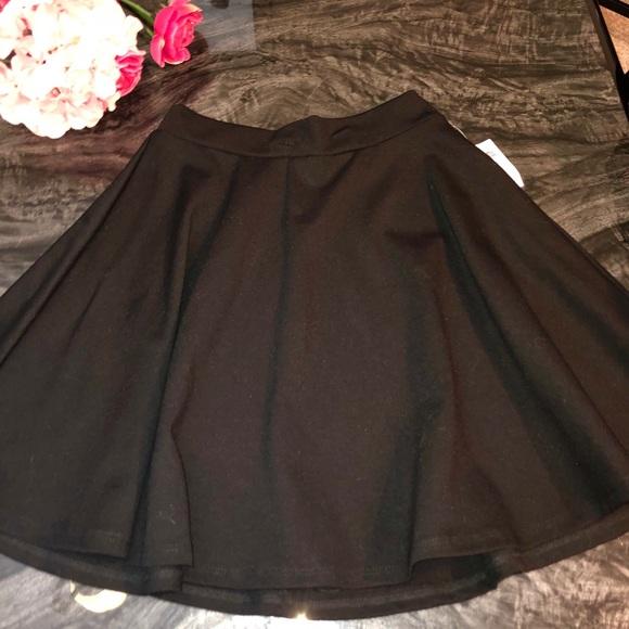 Charlotte Russe Dresses & Skirts - Black flowy Mini Skirt